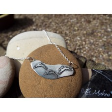 Three Chasing Hares necklace